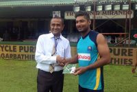"Handing over ""Sanga's thank you"" cards"